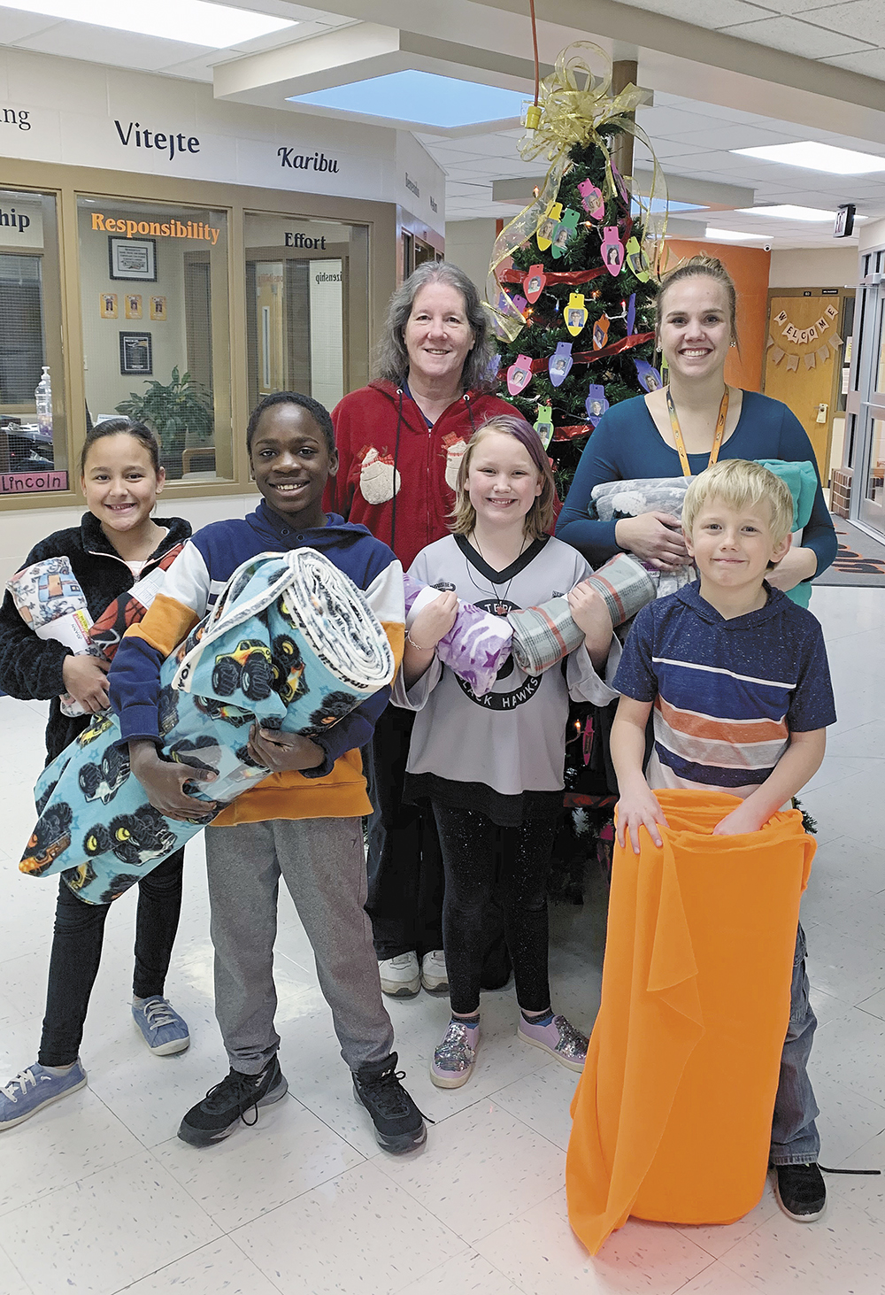 Elementary students make fleece blankets, donate them to the police