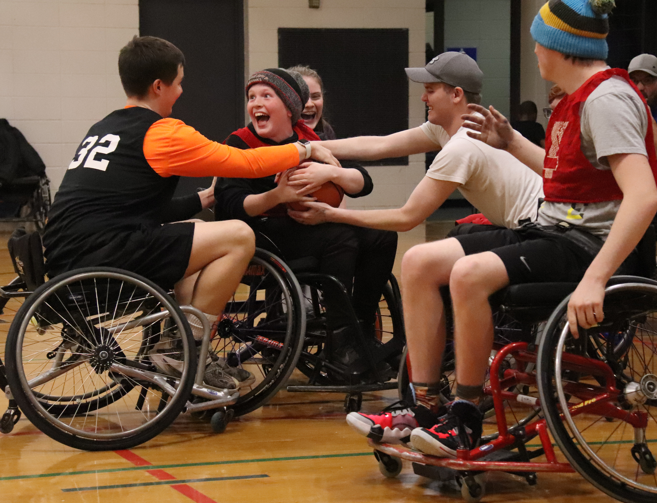 Vertical leap not required to roll with with wheelchair basketball players